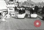 Image of sailors rolling barrels New York United States USA, 1922, second 1 stock footage video 65675060983