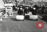Image of sailors rolling barrels New York United States USA, 1922, second 2 stock footage video 65675060983