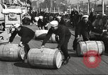 Image of sailors rolling barrels New York United States USA, 1922, second 4 stock footage video 65675060983