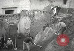 Image of workers Herculaneum Italy, 1932, second 20 stock footage video 65675061020