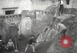 Image of workers Herculaneum Italy, 1932, second 21 stock footage video 65675061020