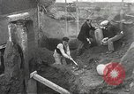 Image of workers Herculaneum Italy, 1932, second 32 stock footage video 65675061020