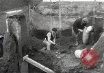 Image of workers Herculaneum Italy, 1932, second 36 stock footage video 65675061020