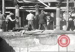 Image of workers Herculaneum Italy, 1932, second 50 stock footage video 65675061020