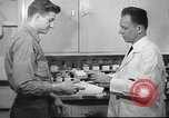 Image of navy personnel United States USA, 1953, second 58 stock footage video 65675061077