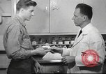 Image of navy personnel United States USA, 1953, second 59 stock footage video 65675061077