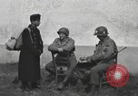 Image of US soldiers interview Hungarian military school boys Freyung Germany, 1945, second 3 stock footage video 65675061211
