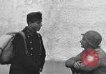 Image of US soldiers interview Hungarian military school boys Freyung Germany, 1945, second 43 stock footage video 65675061211
