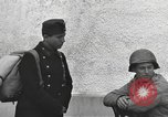 Image of US soldiers interview Hungarian military school boys Freyung Germany, 1945, second 52 stock footage video 65675061211