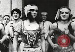 Image of World War 1 US soldiers watching drag queens perform France, 1918, second 11 stock footage video 65675061256