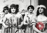 Image of World War 1 US soldiers watching drag queens perform France, 1918, second 15 stock footage video 65675061256