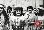 Image of World War 1 US soldiers watching drag queens perform France, 1918, second 18 stock footage video 65675061256