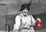 Image of World War 1 US soldiers watching drag queens perform France, 1918, second 28 stock footage video 65675061256