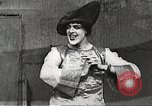 Image of World War 1 US soldiers watching drag queens perform France, 1918, second 30 stock footage video 65675061256
