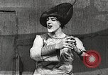 Image of World War 1 US soldiers watching drag queens perform France, 1918, second 34 stock footage video 65675061256