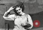 Image of World War 1 US soldiers watching drag queens perform France, 1918, second 37 stock footage video 65675061256