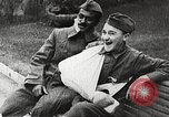 Image of World War 1 US soldiers watching drag queens perform France, 1918, second 45 stock footage video 65675061256