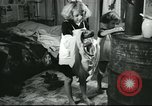 Image of poor farm family United States USA, 1940, second 60 stock footage video 65675061311