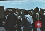 Image of Airmen amuse themselves pitching coins United Kingdom, 1943, second 20 stock footage video 65675061382