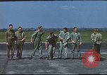 Image of Airmen amuse themselves pitching coins United Kingdom, 1943, second 36 stock footage video 65675061382