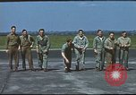 Image of Airmen amuse themselves pitching coins United Kingdom, 1943, second 38 stock footage video 65675061382