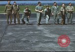 Image of Airmen amuse themselves pitching coins United Kingdom, 1943, second 40 stock footage video 65675061382