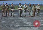 Image of Airmen amuse themselves pitching coins United Kingdom, 1943, second 41 stock footage video 65675061382