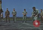 Image of Airmen amuse themselves pitching coins United Kingdom, 1943, second 59 stock footage video 65675061382