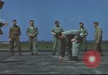 Image of Airmen amuse themselves pitching coins United Kingdom, 1943, second 60 stock footage video 65675061382