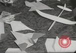 Image of paper airplanes New York City USA, 1967, second 9 stock footage video 65675061510