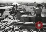Image of Allied P-40 aircraft bombing Japanese at Myitkina in World War II Burma, 1944, second 7 stock footage video 65675061532