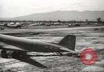 Image of Allied P-40 aircraft bombing Japanese at Myitkina in World War II Burma, 1944, second 14 stock footage video 65675061532