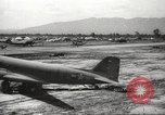Image of Allied P-40 aircraft bombing Japanese at Myitkina in World War II Burma, 1944, second 15 stock footage video 65675061532