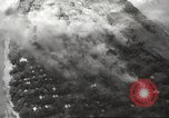 Image of Allied P-40 aircraft bombing Japanese at Myitkina in World War II Burma, 1944, second 54 stock footage video 65675061532