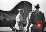 Image of Allied P-40 aircraft bombing Japanese at Myitkina in World War II Burma, 1944, second 60 stock footage video 65675061532