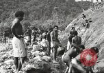 Image of 116th Engineer Battalion 41st Division soldiers New Guinea, 1943, second 19 stock footage video 65675061550