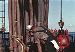 Image of offshore oil rig Atlantic Ocean, 1965, second 5 stock footage video 65675061603