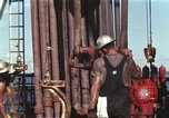 Image of offshore oil rig Atlantic Ocean, 1965, second 14 stock footage video 65675061603