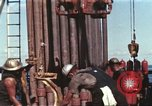 Image of offshore oil rig Atlantic Ocean, 1965, second 15 stock footage video 65675061603