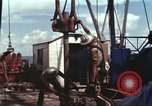 Image of offshore oil rig Atlantic Ocean, 1965, second 39 stock footage video 65675061603