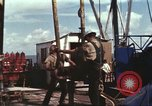 Image of offshore oil rig Atlantic Ocean, 1965, second 49 stock footage video 65675061603