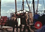 Image of offshore oil rig Atlantic Ocean, 1965, second 50 stock footage video 65675061603
