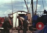 Image of offshore oil rig Atlantic Ocean, 1965, second 53 stock footage video 65675061603