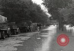 Image of flooded highway Panjao Burma, 1944, second 8 stock footage video 65675061640