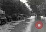Image of flooded highway Panjao Burma, 1944, second 10 stock footage video 65675061640