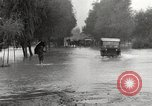 Image of flooded highway Panjao Burma, 1944, second 37 stock footage video 65675061640