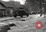Image of flooded highway Panjao Burma, 1944, second 58 stock footage video 65675061640