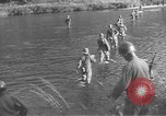 Image of American infantry wading through water Korea, 1953, second 2 stock footage video 65675061714