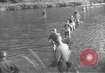 Image of American infantry wading through water Korea, 1953, second 3 stock footage video 65675061714