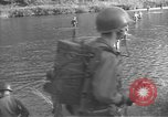 Image of American infantry wading through water Korea, 1953, second 4 stock footage video 65675061714